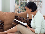 Woman reads on couch